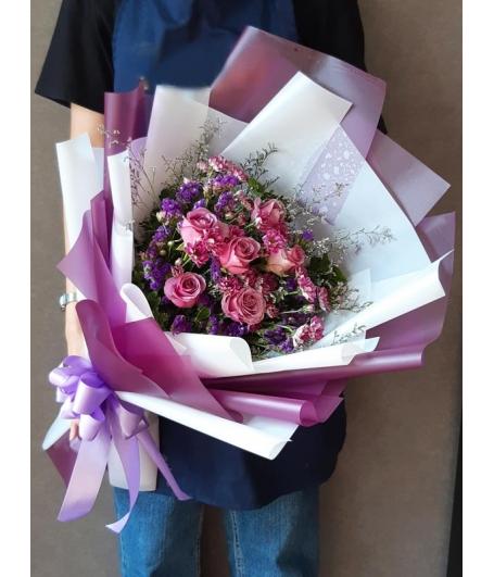 One Dozen Roses In Bouquet